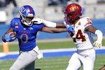 Kansas running back Velton Gardner (0) is forced out of bounds by Iowa State defensive back D.J. Miller Jr. (24) during the first half of an NCAA college football game in Lawrence, Kan., Saturday, Oct. 31, 2020. (AP Photo/Orlin Wagner)