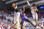 LSU forward Emmit Williams (5) works around Alabama forward/guard Herbert Jones (1) and guard John Petty Jr. (23) to shoot during the first half of an NCAA college basketball game, Saturday, Feb. 15, 2020, in Tuscaloosa, Ala. (AP Photo/Vasha Hunt)