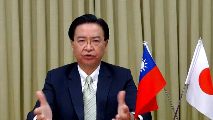 In this image from video released by Foreign Correspondents' Club of Japan, Taiwan Foreign Minister Joseph Wu attends a remote press conference with Foreign Correspondents Club of Japan in Tokyo, Thursday, June 3, 2021. Wu on Thursday said China is seeking political gains abroad in return for providing vaccines and other pandemic assistance, partly to increase pressure on Taiwan, which it claims as its own territory. (FCCJ via AP)