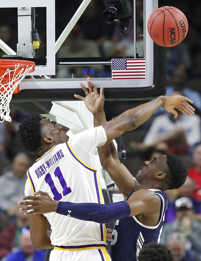 LSU's Kavell Bigby-Williams (11) blocks a shot attempt by Yale 's Miye Oni during the first half of a first round men's college basketball game in the NCAA Tournament, in Jacksonville, Fla. Thursday, March 21, 2019. (AP Photo/John Raoux)