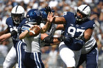 Penn State defensive tackle PJ Mustipher (97) pressures Villanova quarterback Daniel Smith (12) during an NCAA college football game in State College, Pa., on Saturday, Sept. 25, 2021. (AP Photo/Barry Reeger)