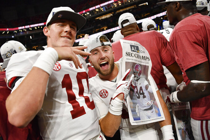 Alabama players celebrate after the second half of the Southeastern Conference championship NCAA college football game against Georgia, Saturday, Dec. 1, 2018, in Atlanta. Alabama won 35-28. (AP Photo/John Amis)