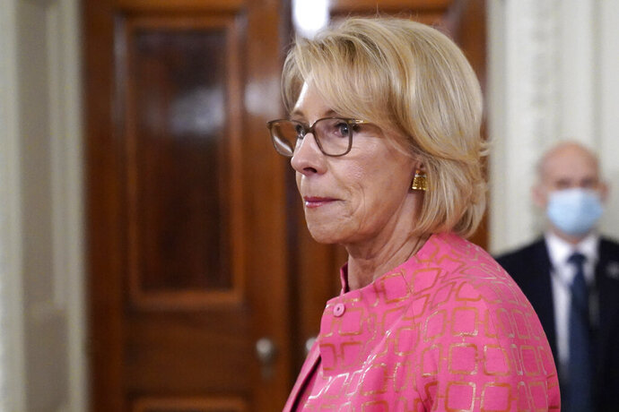 """Education Secretary Betsy DeVos arrives for an event in the State Dining room of the White House, Wednesday, Aug. 12, 2020, in Washington. A federal judge on Wednesday allowed the Education Department to move forward with new rules governing how schools and universities respond to complaints of sexual assault. DeVos said the ruling is """"yet another victory for students and reaffirms that students' rights under Title IX go hand in hand with basic American principles of fairness and due process."""" (AP Photo/Andrew Harnik, File)"""