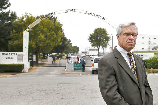 FILE - In this Sept. 30, 2015, file photo, Don Knight, attorney for death row inmate Richard Glossip, waits to enter the grounds of the State Penitentiary in McAlester, Okla, for the scheduled execution of Glossip. Knight testified Wednesday, Oct. 14, 2020, before the Oklahoma House Public Safety Committee during a hearing about the death penalty, that he has uncovered new potential witnesses in the case whom he is unable to present to a court under current state law. (AP Photo/Sue Ogrocki, File)