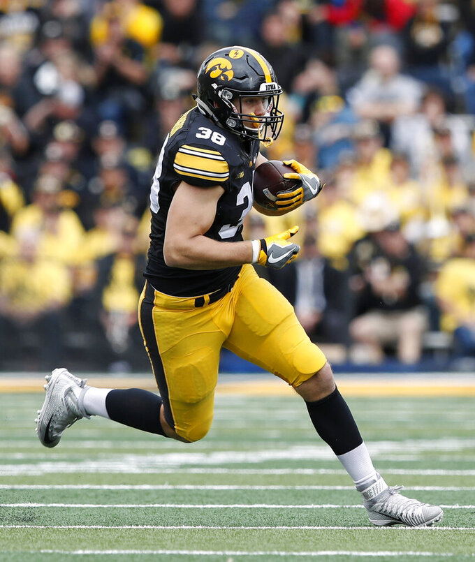 FILE - In this Oct. 7, 2017, file photo, Iowa tight end T.J. Hockenson catches a pass during the second half of an NCAA college football game against Illinois, in Iowa City, Iowa. Hockenson is leaving school early for the NFL. The Hawkeyes announced on Monday, Jan. 14, 2019,  that Hockenson, a redshirt sophomore, will join teammates Noah Fant, Anthony Nelson and Amani Hooker as early entrees in the draft. (AP Photo/Charlie Neibergall, File)