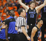 Duke's Zion Williamson, left, and teammates cheer after a Duke basket during the second half of an NCAA college basketball game against Syracuse in Syracuse, N.Y., Saturday, Feb. 23, 2019. Duke won 75-65. (AP Photo/Nick Lisi)