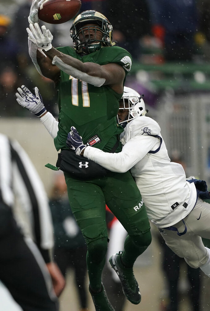 Colorado State wide receiver Preston Williams (11) catches a touchdown pass against Utah State cornerback DJ Williams (7) during the second half of an NCAA college football game Saturday, Nov. 17, 2018, in Fort Collins, Colo. (AP Photo/Jack Dempsey)