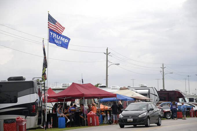 A United States and President Donald Trump campaign flag fly in the infield before a NASCAR Cup Series auto race at Daytona International Speedway, Saturday, July 6, 2019, in Daytona Beach, Fla. (AP Photo/Phelan M. Ebenhack)