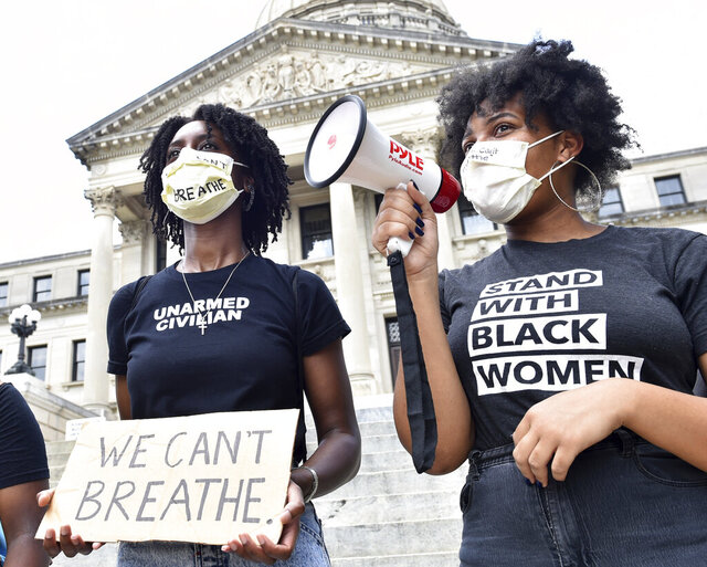 Protesters, who did not wish to be identified, chant outside the Mississippi State Capitol building in Jackson, Miss. on Friday afternoon following comments made by Petal Mayor Hal Marx regarding the death of George Floyd on Monday in Minneapolis. Friday, May 28, 2020.  (Sarah Warnock/The Clarion-Ledger via AP)