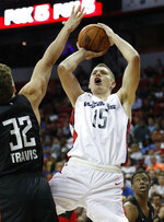 Washington Wizards Moritz Wagner shoots over Atlanta Hawks' Reid Travis during the first half of an NBA summer league basketball game Thursday, July 11, 2019, in Las Vegas. (AP Photo/John Locher)