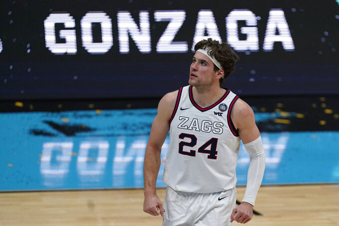 Gonzaga forward Corey Kispert (24) reacts after making a 3-point basket during the first half of a men's Final Four NCAA college basketball tournament semifinal game against UCLA, Saturday, April 3, 2021, at Lucas Oil Stadium in Indianapolis. (AP Photo/Michael Conroy)