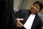 -FILE- In this Wednesday, April 4, 2018 image, chief prosecutor Fatou Bensouda waits for alleged jihadist leader Al Hassan Ag Abdoul Aziz Ag Mohamed Ag Mahmoud to enter the court room at the International Criminal Court in The Hague, Netherlands. Judges at the International Criminal Court have rejected a request by the court's prosecutor to open an investigation into war crimes and crimes against humanity in Afghanistan and alleged crimes by U.S. forces linked to the conflict. In a decision Friday, judges said an investigation