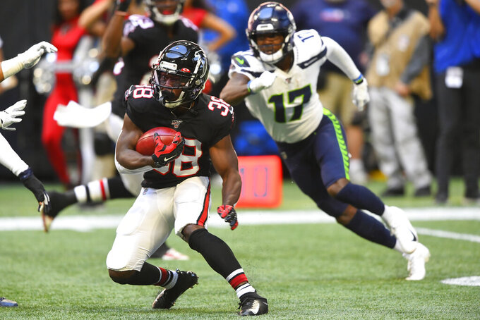 Atlanta Falcons running back Kenjon Barner (38) runs against the Seattle Seahawks during the first half of an NFL football game, Sunday, Oct. 27, 2019, in Atlanta. (AP Photo/John Amis)