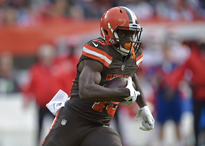 FILE - In this Nov. 4, 2018, file photo, Cleveland Browns wide receiver Breshad Perriman (19) runs after a catch during the second half of an NFL football game against the Kansas City Chiefs in Cleveland. Perriman will re-sign with the Cleveland Browns after a bounce-back season. He was set to hit the free-agent market on Wednesday, March 13, 2019. (AP Photo/David Richard, File)