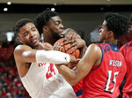 Houston forward Breaon Brady (24) grapples for control of the ball with New Jersey Institute of Technology forward Abdul Lewis, middle, and guard Diandre Wilson (15) during the first half of an NCAA college basketball game Saturday, Dec. 29, 2018, in Houston. The play resulted in a double technical foul on both teams. (AP Photo/Michael Wyke)