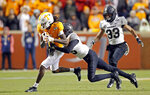 Tennessee wide receiver Marquez Callaway (1) is tackled by Vanderbilt defensive back BJ Anderson (16) as safety Dashaun Jerkins (33) trails in the second half of an NCAA college football game Saturday, Nov. 30, 2019, in Knoxville, Tenn. (AP Photo/Wade Payne)