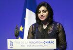 FILE - In this Nov. 24 2016 file photo, Pakistan's Gulalai Ismail delivers an acceptance speech after being awarded the Prize for Conflict Prevention for the work of her organization 'Aware Girls' promoting women's issues and equality in Pakistan, during the award ceremony of the Jacques Chirac Foundation at the Musee Branly, in Paris, France. On Thursday, Oct. 17, 2019, a dozen plainclothes Pakistani security forces attempted to raid the former home of Ismail, a human rights activist who recently fled to the United States seeking asylum. Ismail's elderly parents say they were ordered to come outside