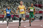 From left, Brazil's Alan Fonteles Cardoso Oliveira, Germany's Felix Streng and South Africa's Mpumelelo Mhlongo compete during the men's 100m T64 heats in the 2020 Paralympics at the National Stadium in Tokyo, Sunday, Aug. 29, 2021. (AP Photo/Eugene Hoshiko)