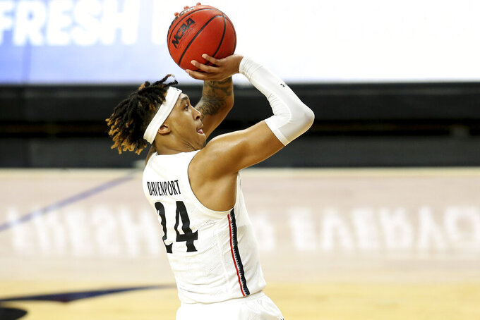 Cincinnati guard Jeremiah Davenport (24) tries for a three-point basket in the first half of an NCAA college basketball game against Vanderbilt, Thursday, March 4, 2021, in Cincinnati. (Kareem Elgazzar/The Cincinnati Enquirer via AP)