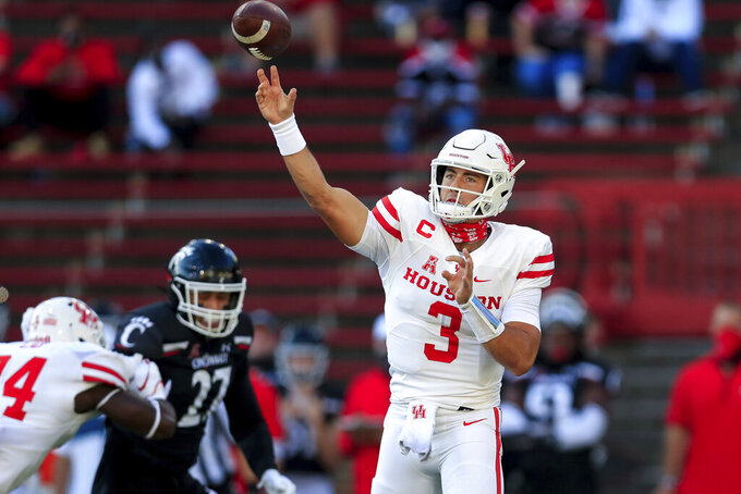 Houston quarterback Clayton Tune throws a pass during the first half of an NCAA college football game against Cincinnati, Saturday, Nov. 7, 2020, in Cincinnati. (AP Photo/Aaron Doster)