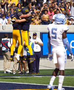 California running back Patrick Laird (28) celebrates his touchdown run with quarterback Chase Garbers during the second half of an NCAA college football game, Saturday, Sept. 1, 2018, in Berkeley, Calif. California won 24-17. (AP Photo/D. Ross Cameron)