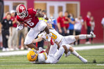 Indiana running back Stephen Carr (5) is hit by Idaho linebacker Coleman Johnson (10) and cornerback Marcus Harris (11) during the first half of an NCAA college football game, Saturday, Sept. 11, 2021, in Bloomington, Ind. (AP Photo/Doug McSchooler)