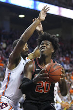 Georgia forward Rayshaun Hammonds (20) shoots defended by Auburn forward Anfernee McLemore (24) during the first half of an NCAA college basketball game Saturday, Jan. 11 2020, in Auburn, Ala. (AP Photo/Julie Bennett)