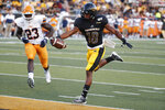 Southern Mississippi wide receiver De'Michael Harris (18) stretches the football past UTEP defensive end Praise Amaewhule (23) on a two-yard touchdown run during the first half of their NCAA college football game in Hattiesburg, Miss., Saturday, Sept. 28, 2019. (AP Photo/Rogelio V. Solis)