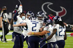Tennessee Titans kicker Sam Sloman (2) celebrates with teammates after kicking the game-winning field goal against the Houston Texans during the second half of an NFL football game Sunday, Jan. 3, 2021, in Houston. The Titans won 41-38. (AP Photo/Sam Craft)
