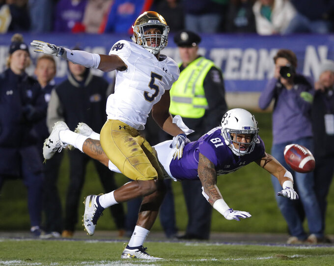 FILE - In this Nov. 3, 2018, file photo, Northwestern's Ramaud Chiaokhiao-Bowman, right, dives for the ball but cannot make the catch as Notre Dame's Troy Pride Jr. defends during the first half of an NCAA college football game in Evanston, Ill. Notre Dame plays Clemson on Dec. 29 in a college football playoff semifinal in Arlington, Texas. (AP Photo/Jim Young, File)