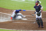 New York Mets' Michael Conforto scores past Atlanta Braves catcher Travis D'Arnaud on a single by Robinson Cano during the third inning of a baseball game Monday, Aug. 3, 2020,, in Atlanta. (Curtis Compton/Atlanta Journal-Constitution via AP)