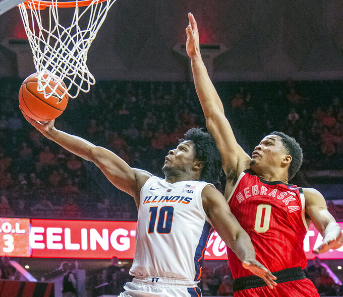 Illinois guard Andres Feliz (10) and Nebraska guard James Palmer Jr. (0) during the second half of an NCAA college basketball game in Champaign, Ill., Saturday, Feb. 2, 2019. (AP Photo/Robin Scholz)