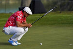 Bryson DeChambeau lines up a putt on the 10th hole during the second round of the PGA Championship golf tournament at TPC Harding Park Friday, Aug. 7, 2020, in San Francisco. (AP Photo/Jeff Chiu)