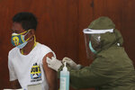 A man receives a shot of the Sinovac vaccine for COVID-19 during a vaccination campaign in Jakarta, Indonesia, Monday, July 12, 2021. (AP Photo/Achmad Ibrahim)
