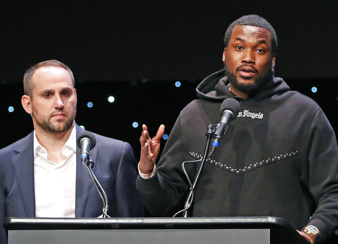 Recording artist Meek Mill, right, speaks about his incarceration along with Philadelphia 76ers co-owner and Fanatics executive chairman Michael Rubin at the launch of REFORM Alliance, a partnership among entertainment moguls, entrepreneurs, recording artists, and business and sports leaders who hope to transform the American criminal justice system, Wednesday, Jan. 23, 2019, in New York. (AP Photo/Kathy Willens)