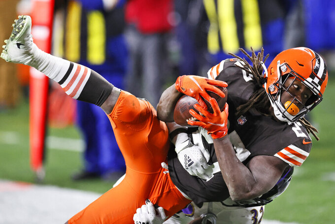Cleveland Browns running back Kareem Hunt scores a 22-yard touchdown after a pass during the second half of an NFL football game against the Baltimore Ravens, Monday, Dec. 14, 2020, in Cleveland. The Ravens won 47-42. (AP Photo/Ron Schwane)