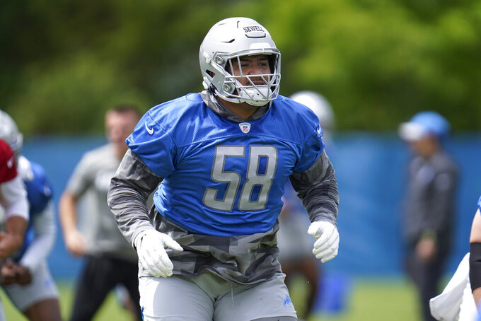FILE - Detroit Lions offensive tackle Penei Sewell runs a drill during NFL football practice in Allen Park, Mich., in this Thursday, June 3, 2021, file photo. Sewell, drafted No. 7 overall, has faced an NFL opponent for the first time and quickly knows he has a lot of work to do. (AP Photo/Paul Sancya, File)