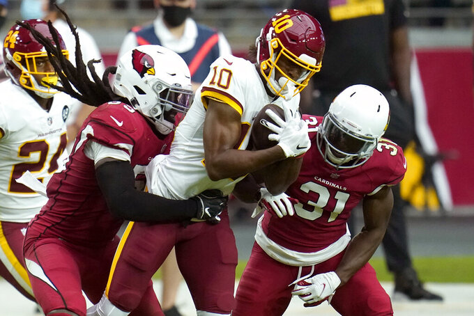 Washington Football Team wide receiver Antonio Gandy-Golden (10) is hit by Arizona Cardinals outside linebacker De'Vondre Campbell and safety Chris Banjo (31) during the second half of an NFL football game, Sunday, Sept. 20, 2020, in Glendale, Ariz. (AP Photo/Ross D. Franklin)