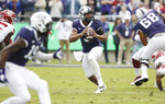 TCU quarterback Shawn Robinson (3) looks for a receiver during the first half of an NCAA college football game against Oklahoma, Saturday, Oct. 20, 2018, in Fort Worth, Texas. (AP Photo/Brandon Wade)