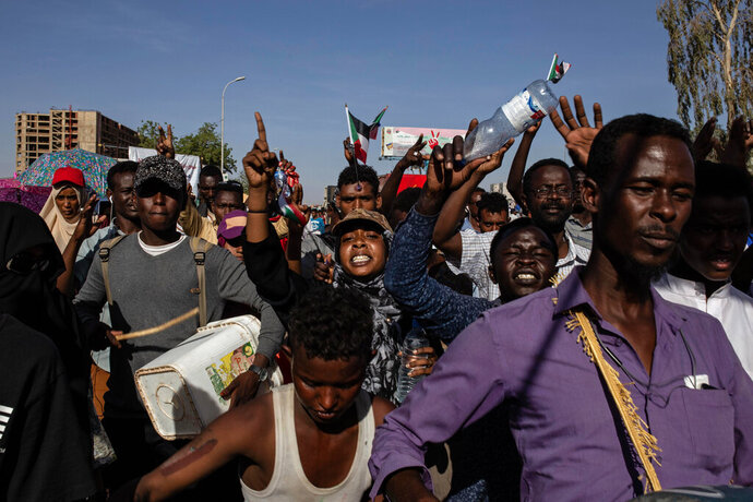 Demonstrators rally near the military headquarters in Khartoum, Sudan, Monday, April 15, 2019. The Sudanese protest movement on Monday welcomed the