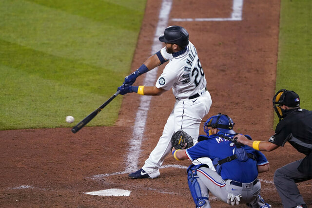 Seattle Mariners' Jose Marmolejos hits a single to score Kyle Seager during the eighth inning of the team's baseball game against the Texas Rangers, Saturday, Sept. 5, 2020, in Seattle. (AP Photo/Ted S. Warren)