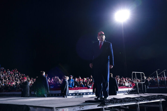 President Donald Trump walks off stage after speaking during a campaign rally at Richard B. Russell Airport, Sunday, Nov. 1, 2020, in Rome, Ga. (AP Photo/Evan Vucci)