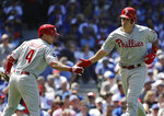 Philadelphia Phillies' J.T. Realmuto, right, celebrates with Scott Kingery after hitting a solo home run against the Chicago Cubs during the third inning of a baseball game Thursday, May 23, 2019, in Chicago. (AP Photo/Nam Y. Huh)