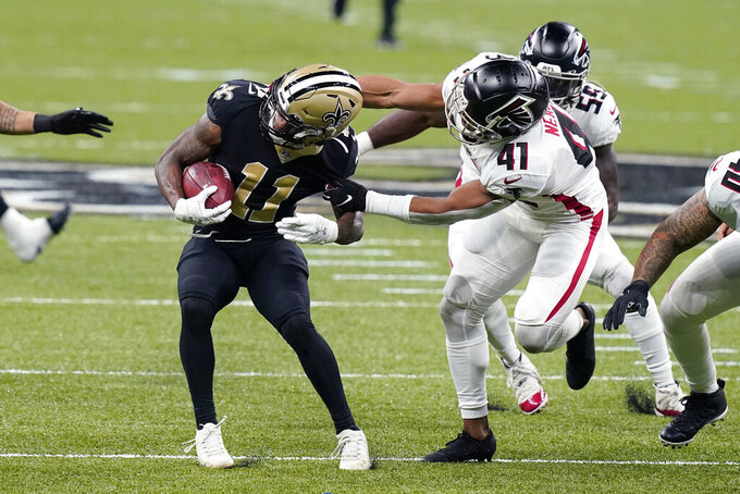 Atlanta Falcons safety Sharrod Neasman (41) tries to tackle New Orleans Saints returner Deonte Harris (11) on a punt return in the first half of an NFL football game in New Orleans, Sunday, Nov. 22, 2020. (AP Photo/Butch Dill)