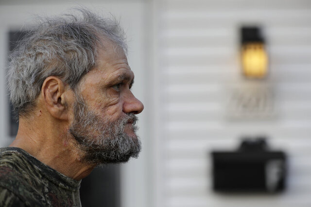 In this Friday, Dec. 20, 2019 photo, Bobby Goldberg looks to the road in front of his home in suburban Chicago. Goldberg has filed a lawsuit claiming he was abused more than 1,000 times in multiple states and countries by the late Donald McGuire, a prominent American Jesuit priest who had close ties to Mother Teresa. (AP Photo/Nam Y. Huh)