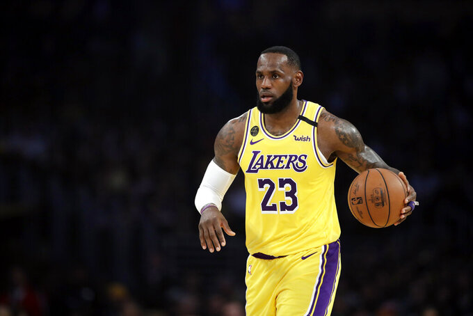 Los Angeles Lakers' LeBron James (23) dribbles during the first half of an NBA basketball game against the Brooklyn Nets Tuesday, March 10, 2020, in Los Angeles. (AP Photo/Marcio Jose Sanchez)