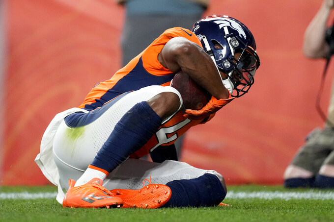 Denver Broncos wide receiver Courtland Sutton scores a touchdown against the Los Angeles Rams during the first half of an NFL preseason football game, Saturday, Aug. 28, 2021, in Denver. (AP Photo/David Zalubowski)