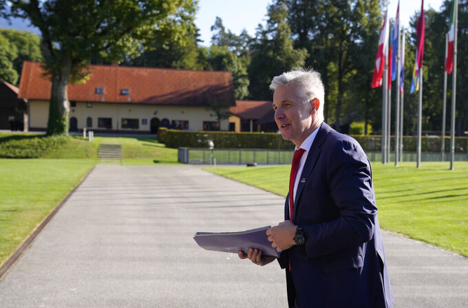Latvia's Defense Minister Artis Pabriks arrives for a meeting of EU defense ministers at the Brdo Congress Center in Kranj, Slovenia, Thursday, Sept. 2, 2021. The collapse of Afghanistan's government, the Taliban's takeover of the country, and the rush to evacuate European citizens and Afghan employees have highlighted the European Union's need for its own rapid-reaction military force, senior EU officials say. (AP Photo/Darko Bandic)