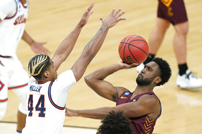 Loyola of Chicago's Keith Clemons (5) shoots against Illinois' Adam Miller (44) during the first half of a college basketball game in the second round of the NCAA tournament at Bankers Life Fieldhouse in Indianapolis Sunday, March 21, 2021. (AP Photo/Mark Humphrey)
