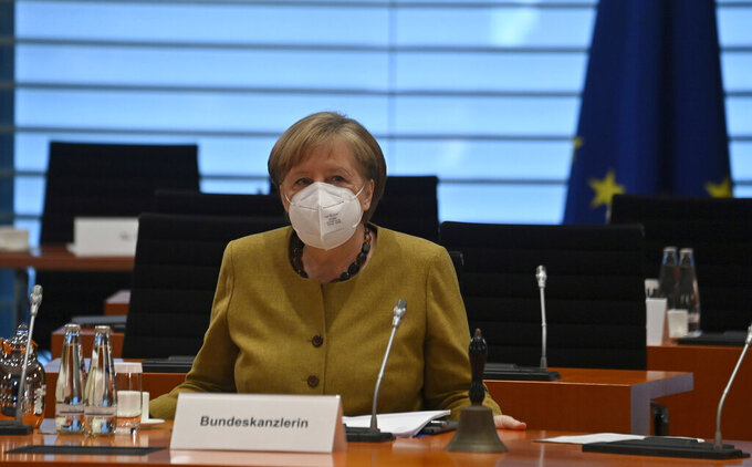 German Chancellor Angela Merkel arrives for the weekly cabinet meeting at the Chancellery in Berlin, Germany, Tuesday April 13, 2021. (John MACDOUGALL/AP via Pool)